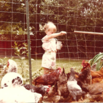 Writer Nicole during her childhood feeding chickens.